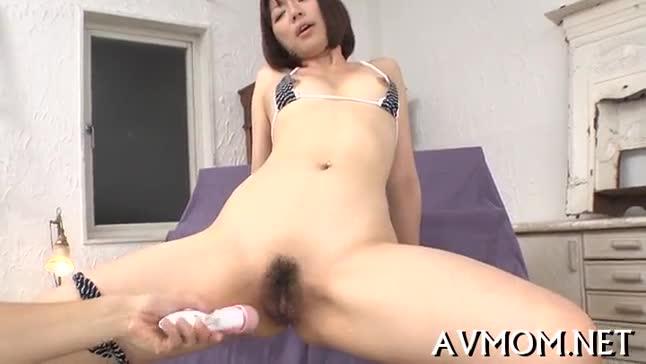 Pretty oriental hottie licking rod