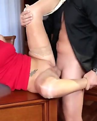 Mature blonde Jenny gets sex on desk