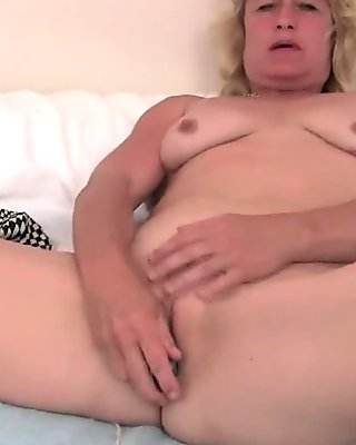 Granny in heat fingers her old pussy