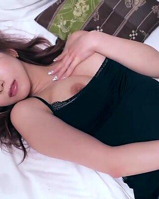 Mion Sonoda busty JAV star stripping in bed
