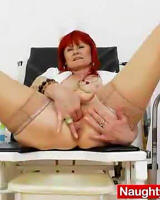 Milada, the hot mama nurse, examines her pink cooter with a latex cock