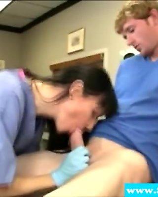 Mature nurse sucking on her patients rod