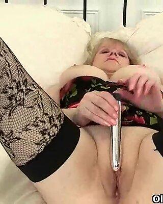British granny fucks herself in stockings