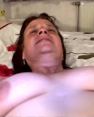 Mature babe toying her pussy and spreading her legs