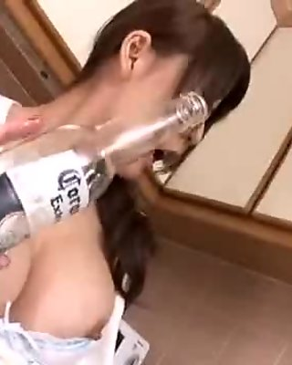 Bosomy Japanese milf sticks a vibrating dildo into her twat